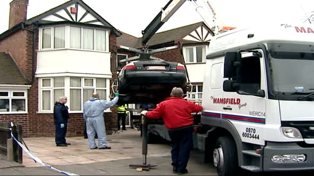 police given seven more days to question nine men birmingham forensic team removing black mercedes car onto pickup truck from one of raided... - paper plate stock videos & royalty-free footage