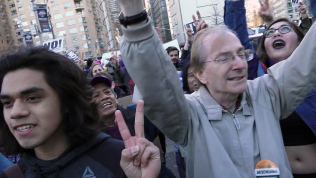 antitrump protesters gathered in the columbus circle 59th street vicinity near the upper west side trump international hotel tower manhattan new york... - presidents day stock videos and b-roll footage