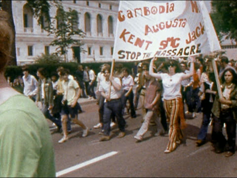 1970 antivietnam war demonstrators marching with banners / newspaper reporter taking notes / detroit - vietnam war stock videos & royalty-free footage
