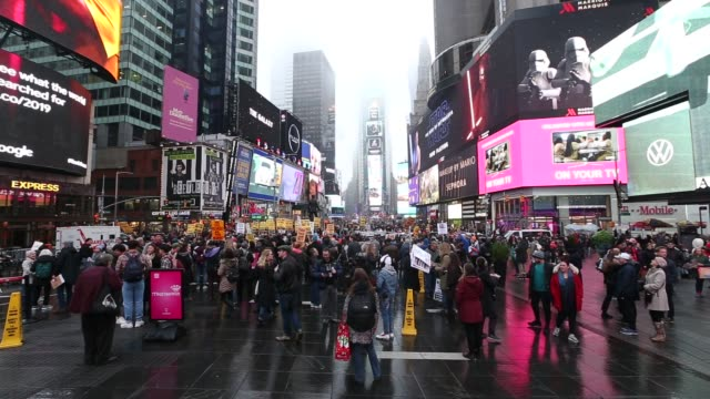 anti-war activists hold banner during a protest organised by 'answer coalition' at times square following the killing of iranian revolutionary... - iraq stock videos & royalty-free footage