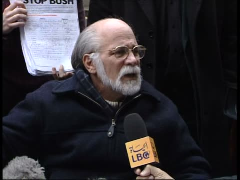 antiwar campaigners deliver petition to 10 downing england london downing street ext ron kovic in wheelchair being push by george galloway mp... - jeremy corbyn stock-videos und b-roll-filmmaterial