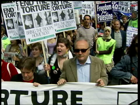antiwar demonstration in london over abuse of iraqi prisoners itn london ext 1621 members of stop the war coalition dressed in camouflage holding... - jeremy corbyn stock-videos und b-roll-filmmaterial