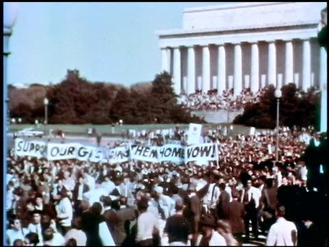 anti-war demonstration put on by the national mobilization committee to end the war in vietnam / crowds holding banner that says, 'support our gis,... - vietnam war stock videos & royalty-free footage