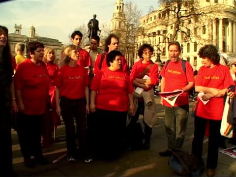 anti-war demonstrations on second anniversary of iraq war; england: london: seq bristol socialist choir singing anti-war song sot clean feed tape =... - choir stock videos & royalty-free footage