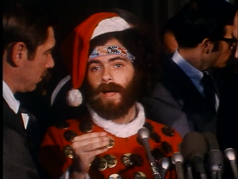 antiwar demonstrator jerry rubin dressed in a santa claus costume gives a press conference after appearing before the house committee on unamerican... - crime or recreational drug or prison or legal trial stock-videos und b-roll-filmmaterial