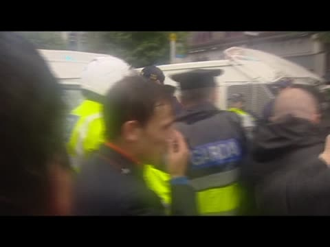 antiwar demonstrators grapple with police during protests outside former prime minister tony blair's autobiography signing - biographie stock-videos und b-roll-filmmaterial