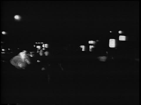 b/w 1967 antiwar demonstrators running from police at night / rome italy / newsreel - anno 1967 video stock e b–roll