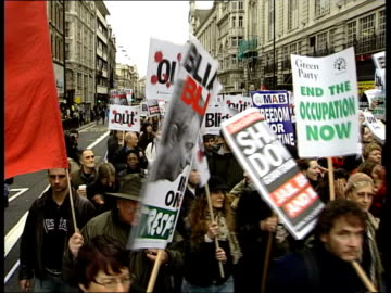 anti-war protest; itn england: london: westminster: ext tbv greenpeace protesters climbing st stephen's tower beside big ben pull out mss bystanders... - chris eubank sr. stock videos & royalty-free footage