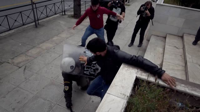 antiwar protesters clash with police as they try to bring down a 35metre statue of former us president harry truman two days after the us uk and... - statue stock videos & royalty-free footage