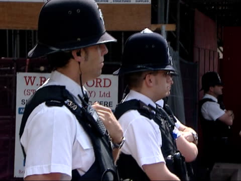 antiwar protesters on streets of bristol as tony blair gives speech at city's university various of police officers standing guard during protest /... - bristol university stock videos and b-roll footage