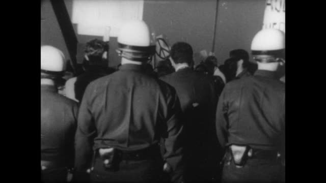 anti-war protestors demonstrate near hotel in los angeles / riot police form line around hotel where president johnson is meeting with premier... - newsreel stock videos & royalty-free footage