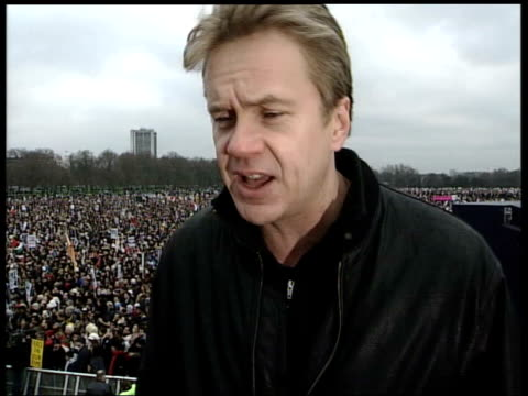anti-war protests; england: london: hyde park: ext 38.02 interview tim robbins sot. ends: 39.30 - tim robbins stock videos & royalty-free footage
