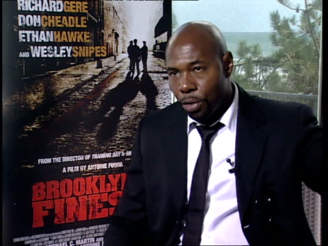 antoine fuqua on his film as a social commentary. people need to be accountable and understand the problems and economic issues. the characters are... - searching点の映像素材/bロール