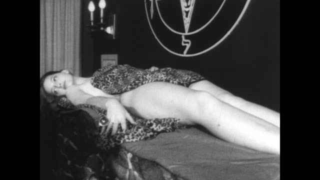 anton lavey performs a satanist wedding for judith case and john raymond in san francisco / judith case and john raymond stand together laughing /... - devil stock videos & royalty-free footage