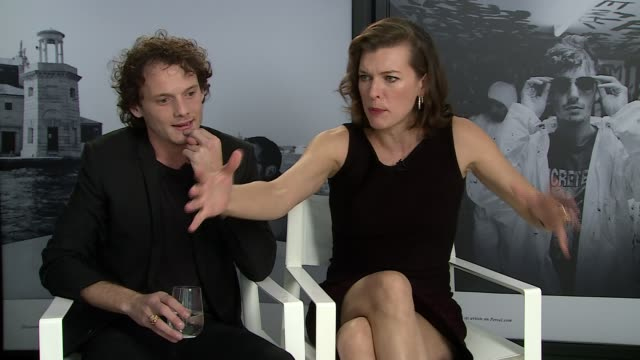 vídeos de stock, filmes e b-roll de interview anton yelchin milla jovovich on why the play isn't better known at 'cymbeline' interviews 71st venice international film festival at persol... - milla jovovich