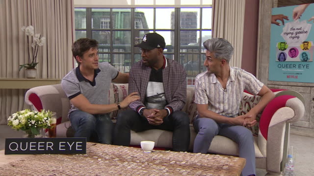 vídeos de stock, filmes e b-roll de antoni porowski, karamo brown, tan france' on the show being a serves job, turning up to work an doing something for someone else at queer eye for... - karamo brown