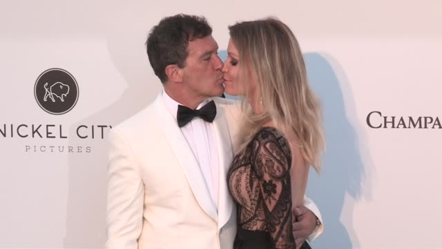 Antonio Banderas and Nicole Kimpel share a kiss on the red carpet for the 2019 Cannes amfAR Gala at Hotel du Cap Eden Roc in Antibes Cannes France on...