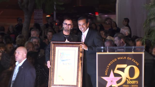 antonio villaraigosa honoring ringo starr at the ringo starr honored with a star on the hollywood walk of fame at hollywood ca - antonio villaraigosa stock videos and b-roll footage
