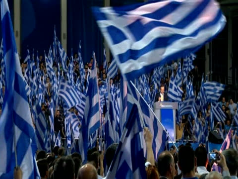 antonis samaras' supporters wave huge flags at party rally in athens - griechische flagge stock-videos und b-roll-filmmaterial
