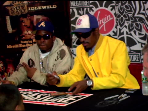 antwan 'big boi' patton and andre '3000' benjamin of outkast sign autographs at the outkast album signing at virgin megastore times square in new... - autographing stock videos & royalty-free footage