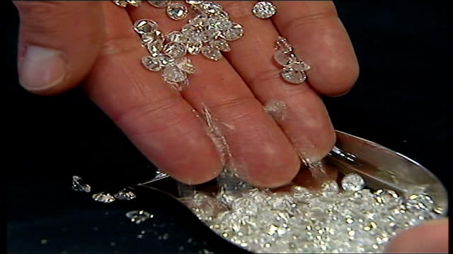 antwerp diamond theft handful of diamonds emptied onto tray close up of cut diamonds dissolve to - handful stock videos & royalty-free footage