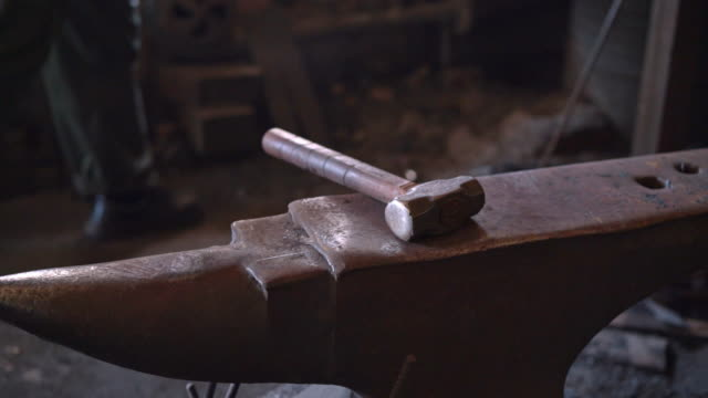 anvil with the hammer in a workshop. - hammer stock videos and b-roll footage