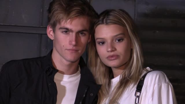 Anwar Hadid and his actress girlfriend NicolaPeltz Presley Gerber and more at the Alexander Wang Ready to Wear Spring Summer 2018 Fashion Show in...