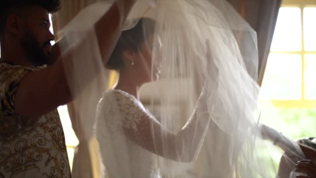 anxious bride wearing the veil before wedding ceremony - wedding dress stock videos & royalty-free footage