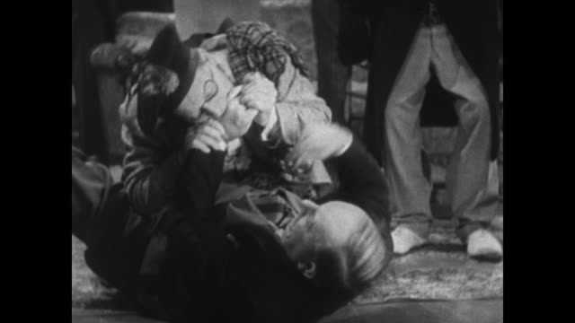 1934 anxious man stops enthusiastic other man from fighting with party guest before everyone called to lunch - 1934 stock videos & royalty-free footage