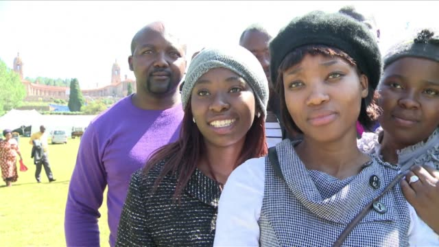 anxious south africans queued through the night for the chance to say a final farewell friday to nelson mandela before his body is moved to his rural... - final chance stock videos & royalty-free footage