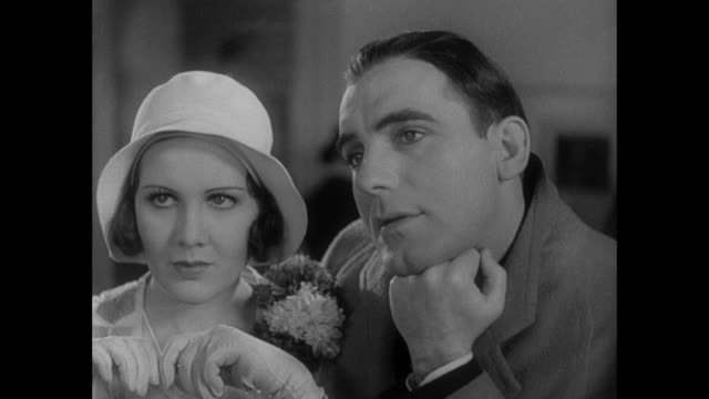 1931 anxious woman (mary brian) and daydreaming man (pat o'brien) pay for marriage license - 1931 stock videos & royalty-free footage