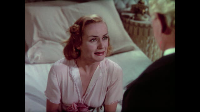 1937 anxious woman (carole lombard) plans her fake suicide with angry doctor (charles winninger) - conspiracy stock videos and b-roll footage