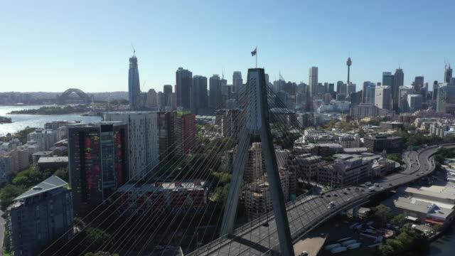 stockvideo's en b-roll-footage met anzac bridge filmed by drone during day on may 10, 2020 in sydney, australia. - sydney australië