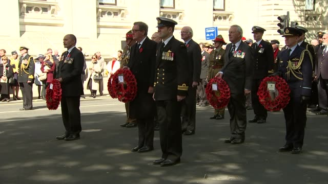 anzac day michael fallon and boris johnson lay wreaths at the cenotaph england london whitehall ext military band playing and veterans marching to... - music stand stock videos & royalty-free footage