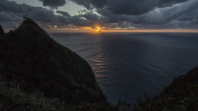 aogashima island -  sunset in the clouds over the sea horizon - honshu stock videos and b-roll footage