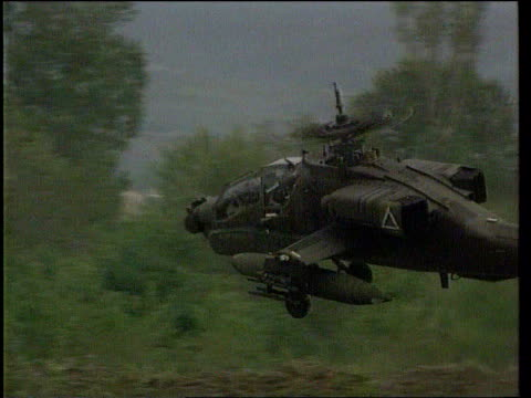 ground to air us apache helicopter along ground to air apache helicopters hovering above ground with troops along in f/g - apache helicopter stock videos and b-roll footage