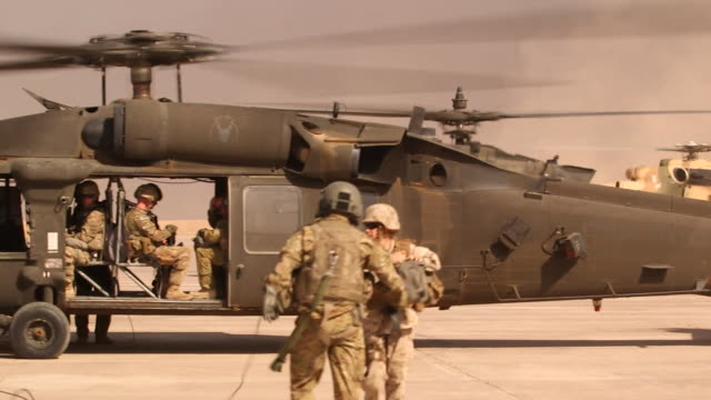 apache helicopters at a us army base, where american soldiers are supporting iraqi and peshmerga fighters in the conflict with islamic state in mosul - iraq stock videos & royalty-free footage