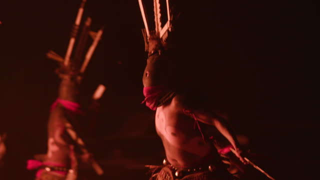 Apache men dance around fire during Sunrise Ceremony, slow motion