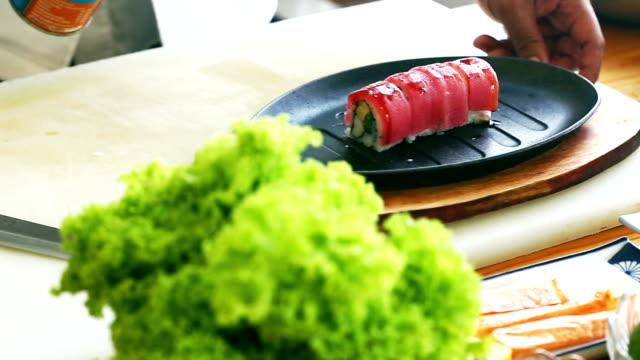 apanese traditional cuisine set of nigiri sushi topped with raw tuna - nigiri stock videos and b-roll footage