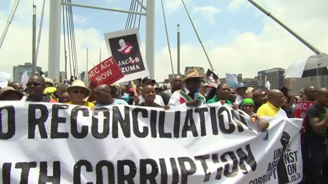 Apartheid campaigners given Freedom of the City of London CUTAWAYS SOUTH AFRICA Johannesburg EXT Various of people protesting against President Jacob...
