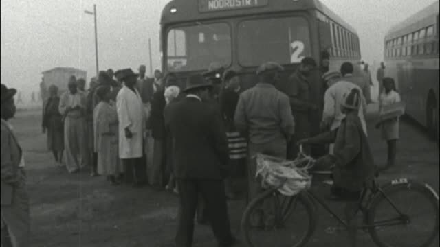 apartheid campaigners given freedom of the city of london cutaways various of black south africans queueing to board bus - south africa stock videos & royalty-free footage
