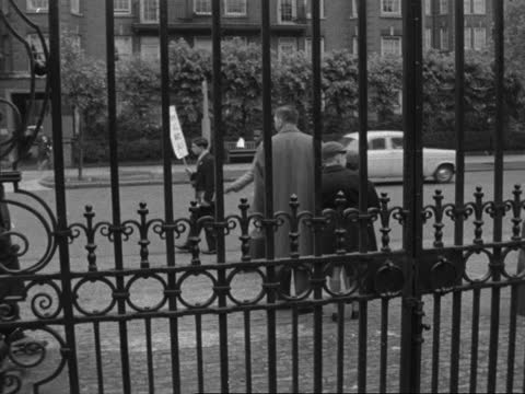 apartheid demonstration outside lords; england: lords: ext gates of lords and pickets outside pickets along with placards cms ditto - walking towards... - moving past stock videos & royalty-free footage