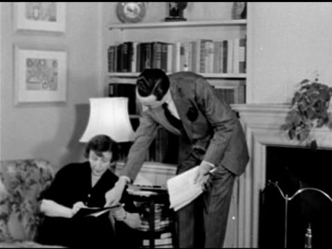 apartment building. author rose franken w/ husband producer william brown maloney in living room. 1947 reprisal: coca-cola representative talking w/... - 1898 stock videos & royalty-free footage