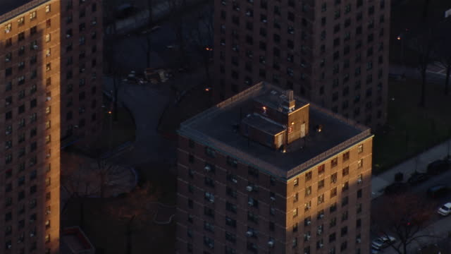Apartment building in New York City Housing Authority public housing project, seen from an aerial view.