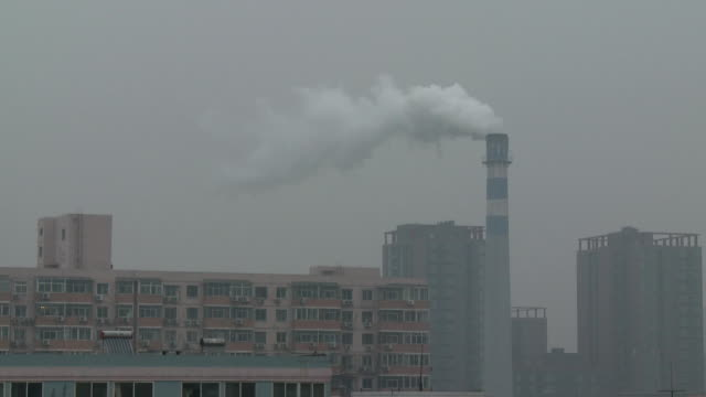vidéos et rushes de ms apartment buildings and smoke stack, beijing, china - répandre