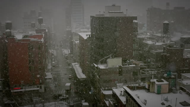 WS HA Apartment buildings and street in snow / New York City, New York, USA