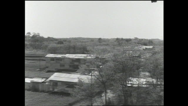 stockvideo's en b-roll-footage met apartment buildings are under construction in setagaya ward field. - 1963