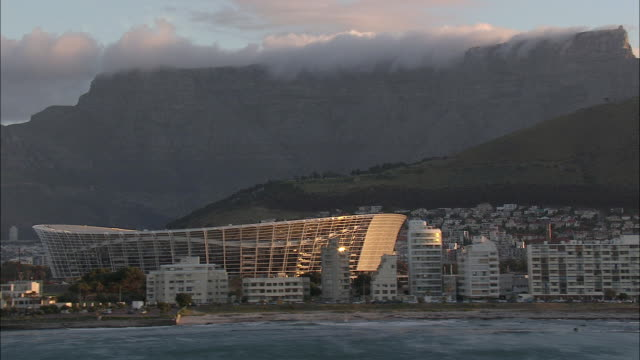 AERIAL Apartment buildings at Green Point and Soccer Stadium with Table Mountain in background, Cape Town, Western Cape, South Africa