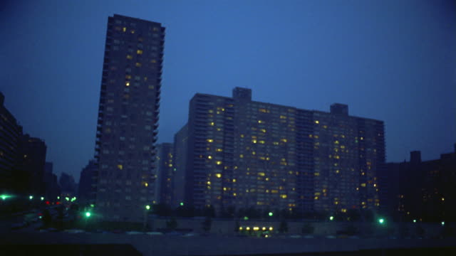1969 t/l apartment buildings at night on upper west side viewed from across amsterdam avenue / new york city - upper west side manhattan stock videos and b-roll footage