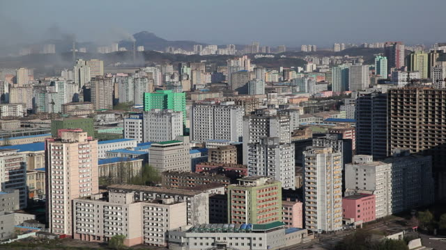 apartment buildings characterize a neighborhood in pyongyang. - pyongyang stock videos and b-roll footage